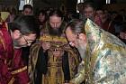 Metropolitan Hilarion dispensing the oil to the priests